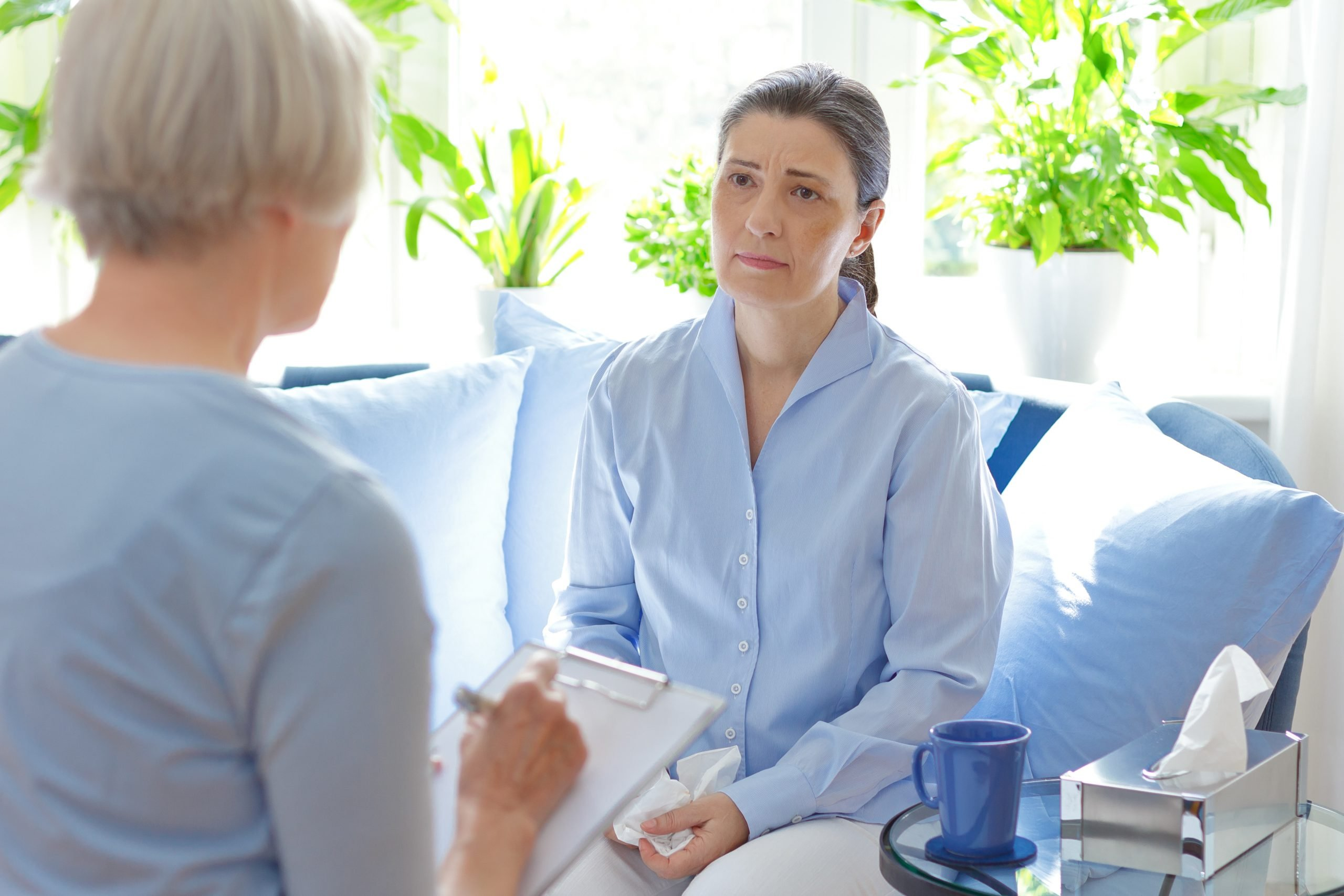 Therapist talking to client, client looks unhappy